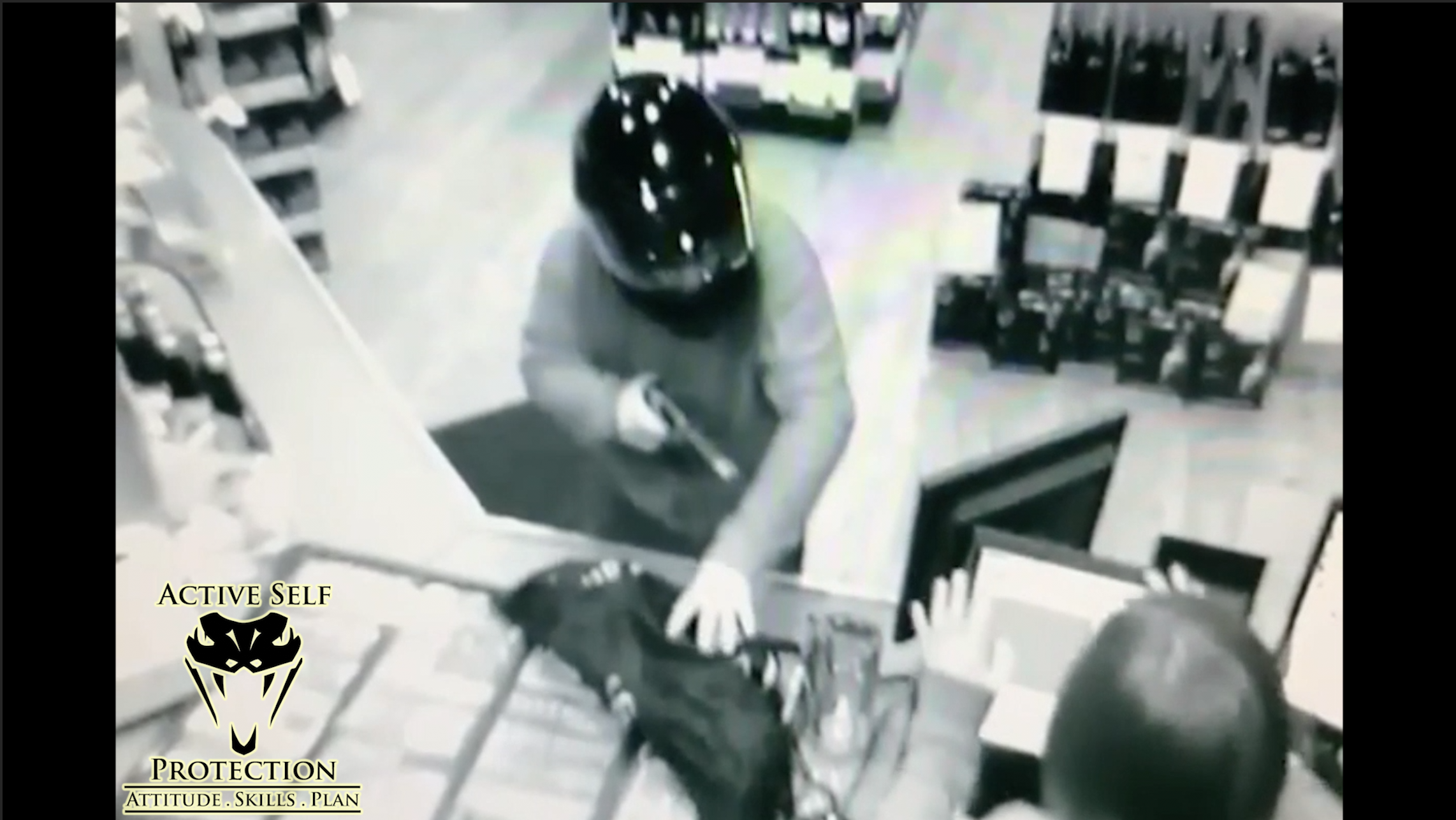 armed robber has the drop on the clerk