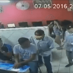 Armed Robbers Try to Take Cop's Gun