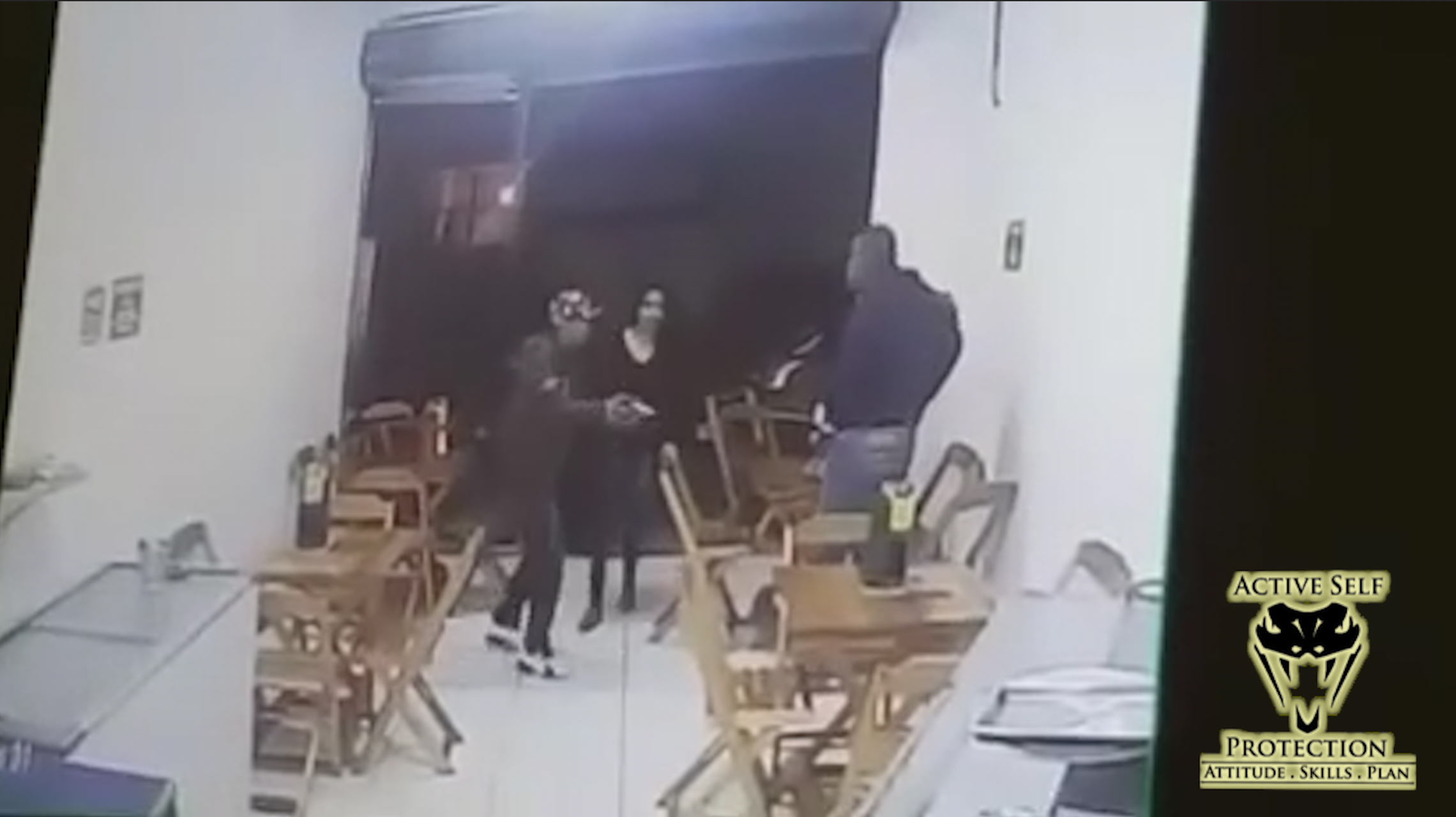 Armed Victim Waits for His Turn Against Armed Robbers